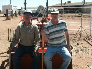 Billy and Terry on tractor with pitch forks