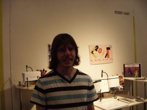 Bobby in front of his BFA Senior Thesis Show display
