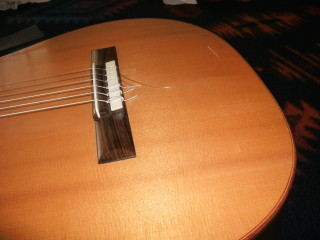 First string shortened before winding on peg