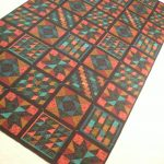 Whole-cloth quilt top basted and ready for straight stitch machine-quilting
