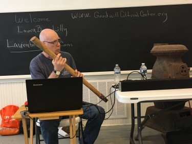 Terry W. Lilly playing the rain stick during my Swimming with Swans presentation at the Goodwill Cultural Center, June 2017