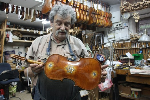 Amnon Weinstein with a restored Star of David violin