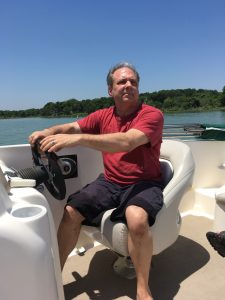My cousin Dennis taking us for a boat ride on Lake Waco, TX