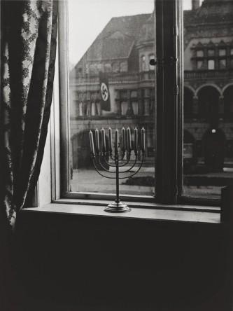 A menorah defies the Nazi flag , 1931