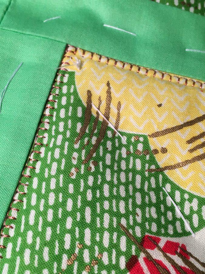 Bright Delight machine blanket stitching with copper metallic thread