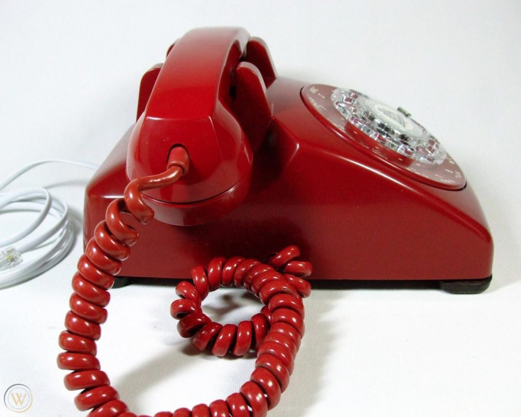 red rotary landline phone with cord